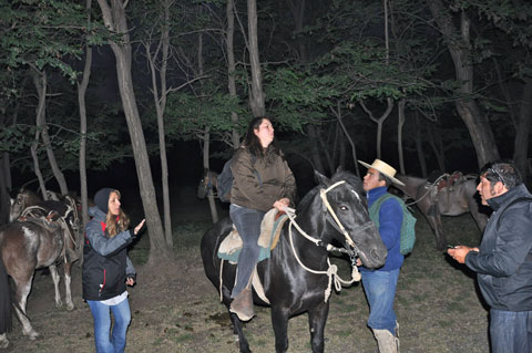 Getting ready to go on a night horse ride in the Andes